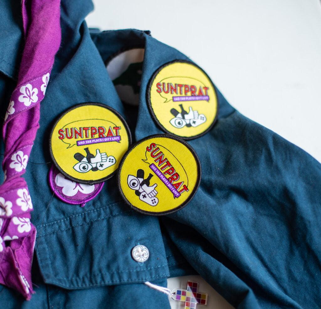 Tygmärke för Suntprat på scoutskjorta